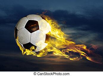 flying fiery soccer ball in sky