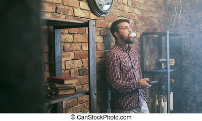 Man Exhaling smoke from a vaporizer shot