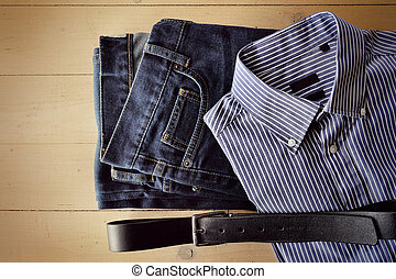Mens clothes decomposed on a wooden background - Mens jeans,...