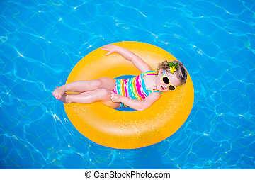 Little girl in swimming pool - Little girl playing in...
