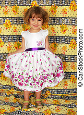 beautiful little girl in white dres