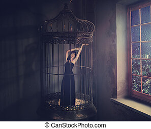 not free - she lives in a cage that hangs in the room