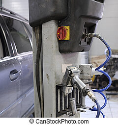 pneumatic tools hanging on a rack lift