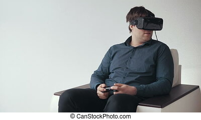 Man Wearing VR Headset and Playing Games with Controller