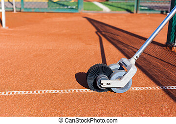 Line Master Brush Cleans the clay court Tennis Championship...