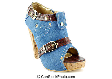woman blue jeans shoe