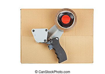 Packaging tape dispenser and shipping box isolated on white...