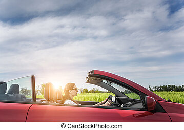 Girl in red cabriolet - Girl in red cabriolet in a field...