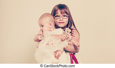 Two little sisters portrait - Sisterly love Two lovely cute...