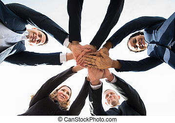 Businesspeople Stacking Hands Over Each Other - Low Angle...