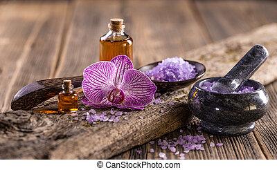 Lavender oil and salt on vintage wooden board