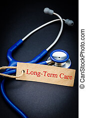 Long term care concept. - Long term care in paper tag with...
