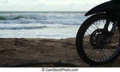 Silhouette of front wheel at beach - Silhouette of front...