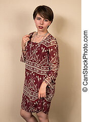 Brunette in red - Pretty young brunette in a brick red print...