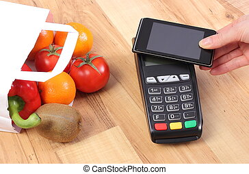 Payment terminal and mobile phone with NFC technology,...