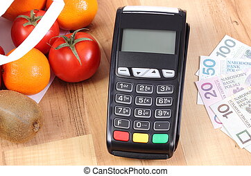 Payment terminal with polish currency, fruits and...