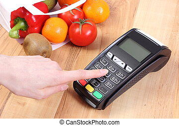 Using payment terminal, fruits and vegetables, cashless...