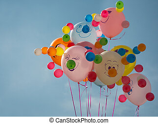 Multi-coloured balloons on a background of the dark blue sky