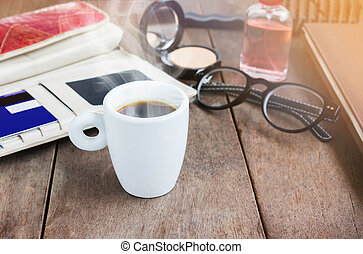 White cup hot black coffee on wood table with working women...