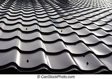 Steel roof tiles - A close view of steel roof tiles for...