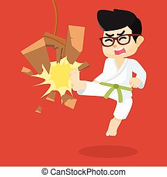 boy green belt karateka breaking board