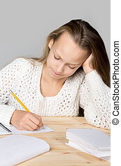 Schoolgirl doing difficult homework - Portrait of stressed...