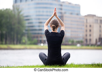 Easy yoga pose on the street - Young woman sitting cross...