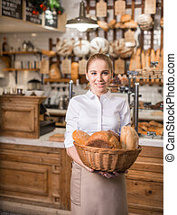 Consumerism - Smiling woman with basket of bread