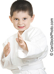 Little karate kid in fighting stand closeup photo