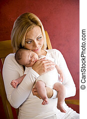 Young mother holding newborn baby boy in arms - Happy young...
