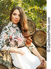 Beautiful brunette girl poses outdoors - Portrait of...
