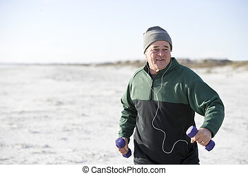 Mature man exercising with hand weights outdoors - Mature...