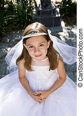 Young girl in white dress and veil outdoors - Young girl...