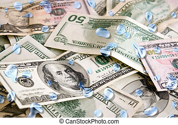 Wet Money - A pile of US dollars with blue water droplets on...