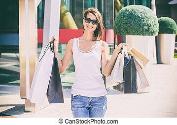 Happy Young Woman Holding Bags - Happy Young Woman Holding...