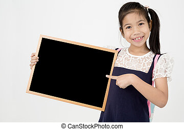 Happy Asian preteens girl hand holding wood board on gray...