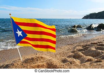 Flag Catalonia at beach