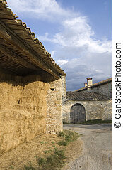 barn and farm door at vers sur meou - Straw filled barn and...