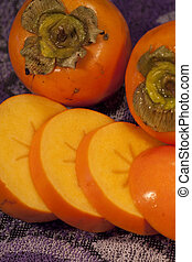 persimmon fruit - Close view of some persimmon fruits on top...