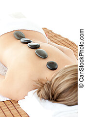Close-up of relaxed woman lying on a massage table