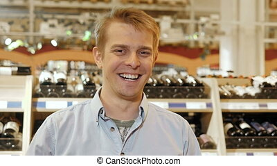 Portrait of Smiling Handsome Man, Wine Store Background,...