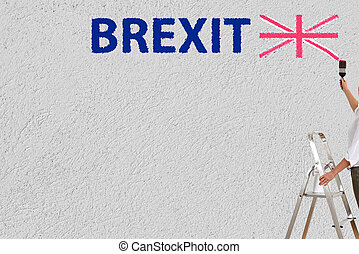 brexit referendum - a woman paint brexit on a wall
