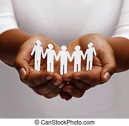 african american female hands with paper people - community,...