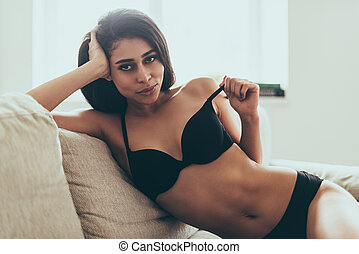 Feeling playful. Beautiful young mixed race woman in black...