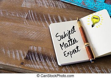 Handwritten text Subject Matter Expert with fountain pen on...