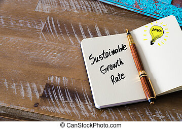 Handwritten text Sustainable Growth Rate with fountain pen...