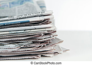 Stack Of Newspapers Horizontal - Stack of newspapers sit on...
