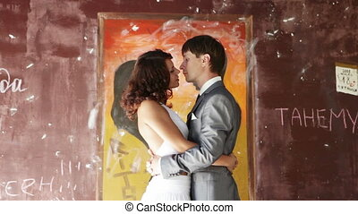 Cute couple kissing - Cute couple holding each other's arms,...