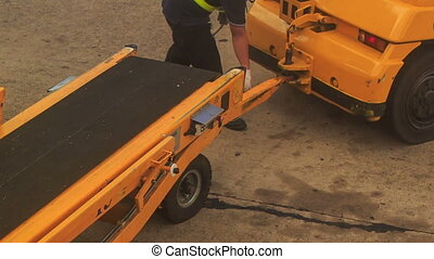 Airport Worker Walks by Ladder Plane