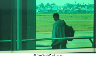 Passengers Board Liner through Loading Bridge in Terminal -...